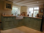 A newly built kitchen hand painted and distressed