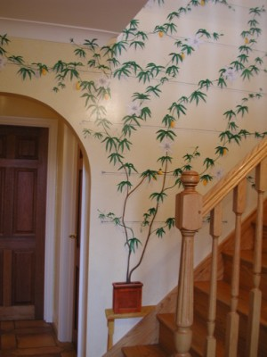 Trompe l'oeil passion flower mural next to the stairs