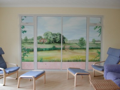 Patio doors have been painted to trick the eye in true trompe l'oeil mural style