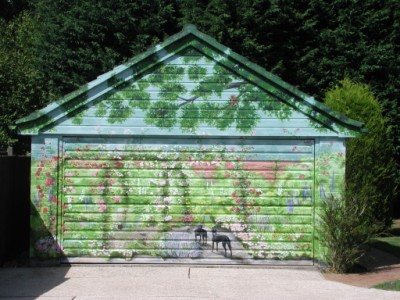An outdoor mural painted on a garage