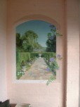 Open up a porch area by painting a trompe l'oeil view